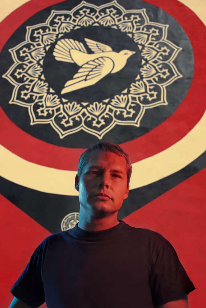 Portrait of the street artist Shepard Fairey. He is in front of one of six pieces that he painted during a summer week in Copenhagen. The portrait is part of the series called D.O.T.S. - Depending On The Street, which is photographer Søren Solkær Starbird's portraiture of an extensive range of the leading lights in street art. It's a book and exhibition project.